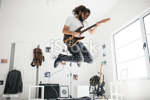 849362192 istock photo Handsome guitarist 849362390