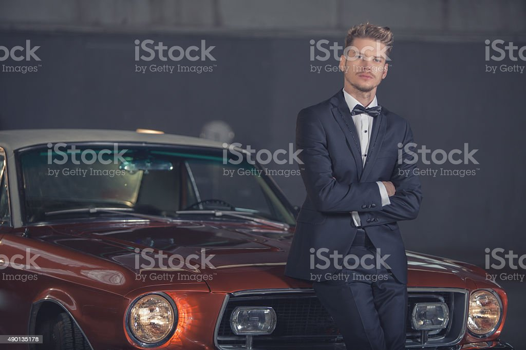 Handsome guy and Classic Car stock photo