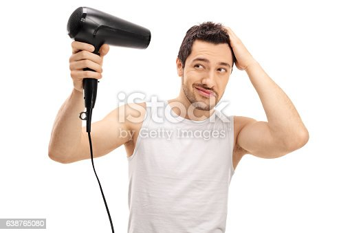 639833996istockphoto Handsome guy blow drying his hair 638765080
