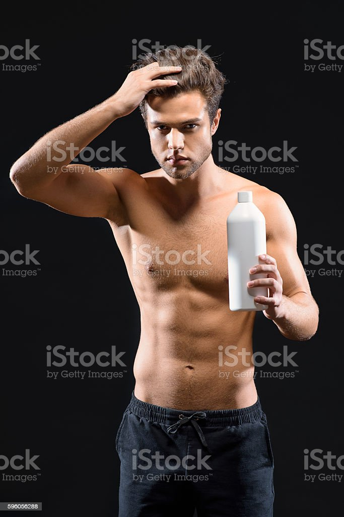 Handsome guy caring of his hairstyle royalty-free stock photo