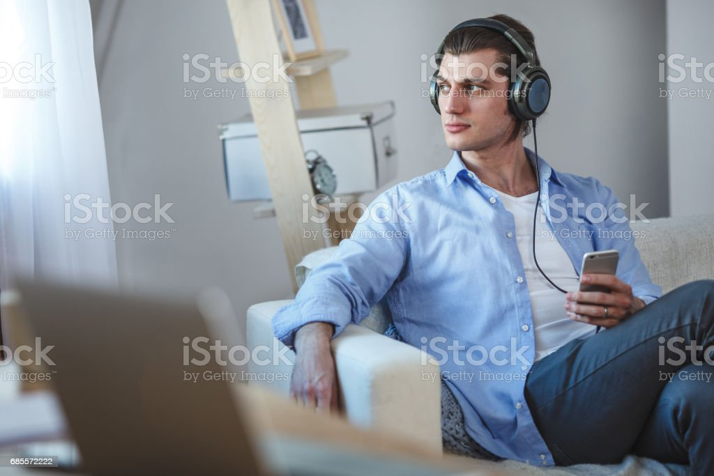 Handsome guy listening to music on internet with smartphone royalty-free 스톡 사진