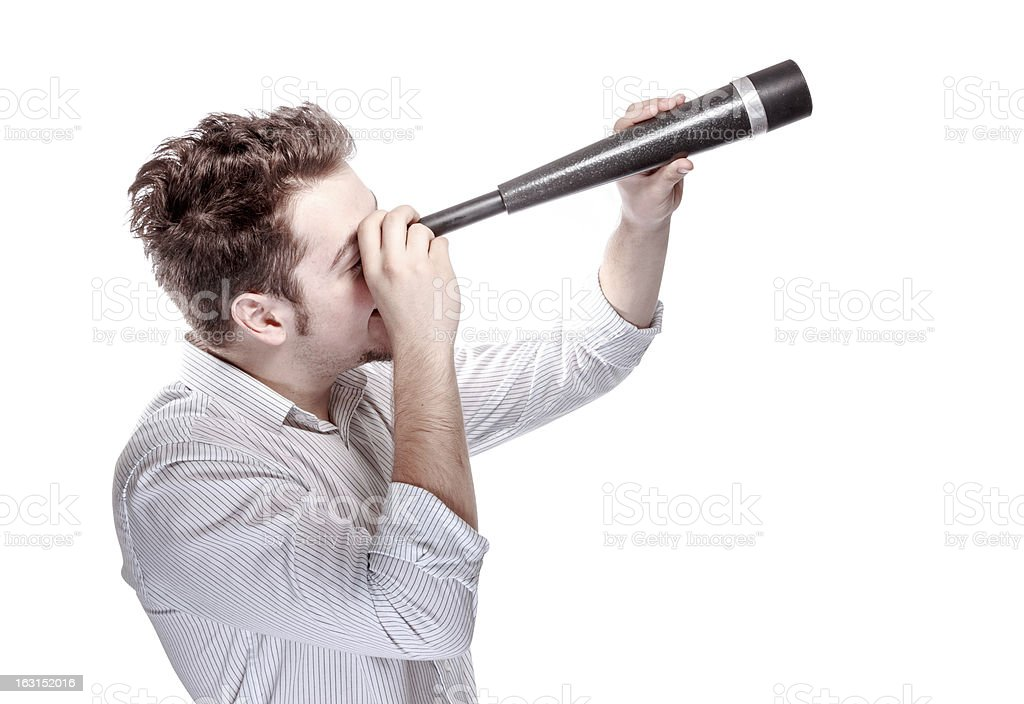 Handsome guy looking through a telescope. stock photo
