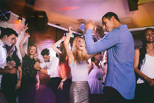 handsome guy of african descent dancing with girlfriend in club - dance floor stock photos and pictures