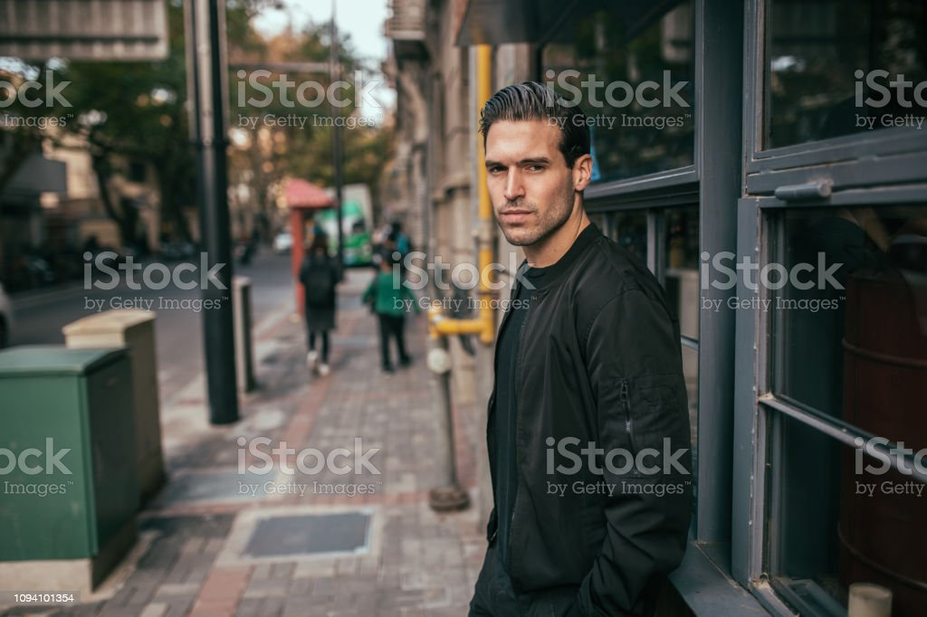 Handsome guy One young handsome guy wearing black outfit, waiting for someone. 25-29 Years Stock Photo