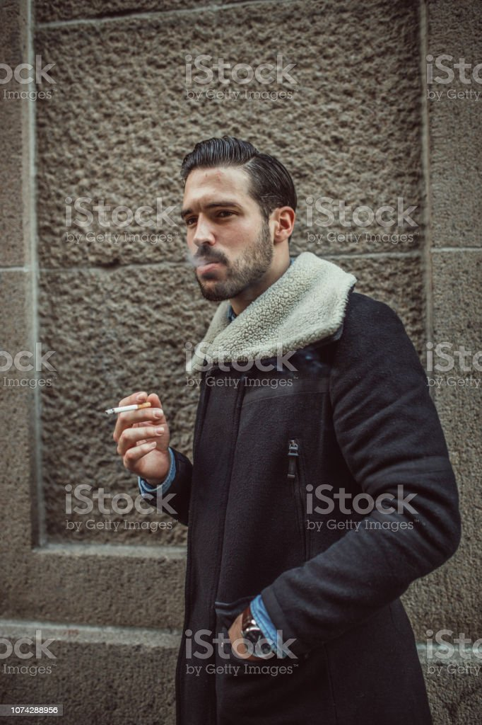 Handsome Guy Smoking Cigarette Stock Photo Download Image Now Istock