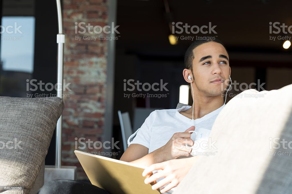 handsome guy using a tablet and listening music royalty-free stock photo