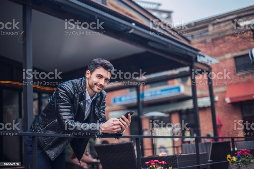 Handsome guy using mobile royalty-free stock photo