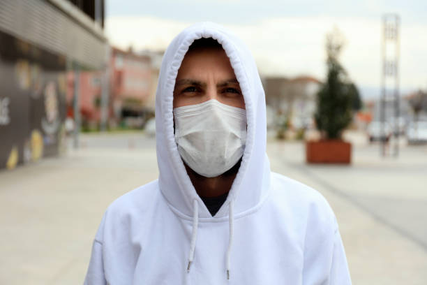 Handsome guy who using protective face mask. stock photo