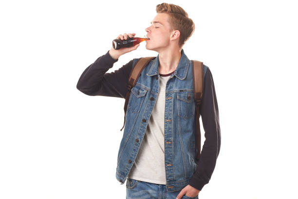 handsome guy with cola - bottle soft drink foto e immagini stock