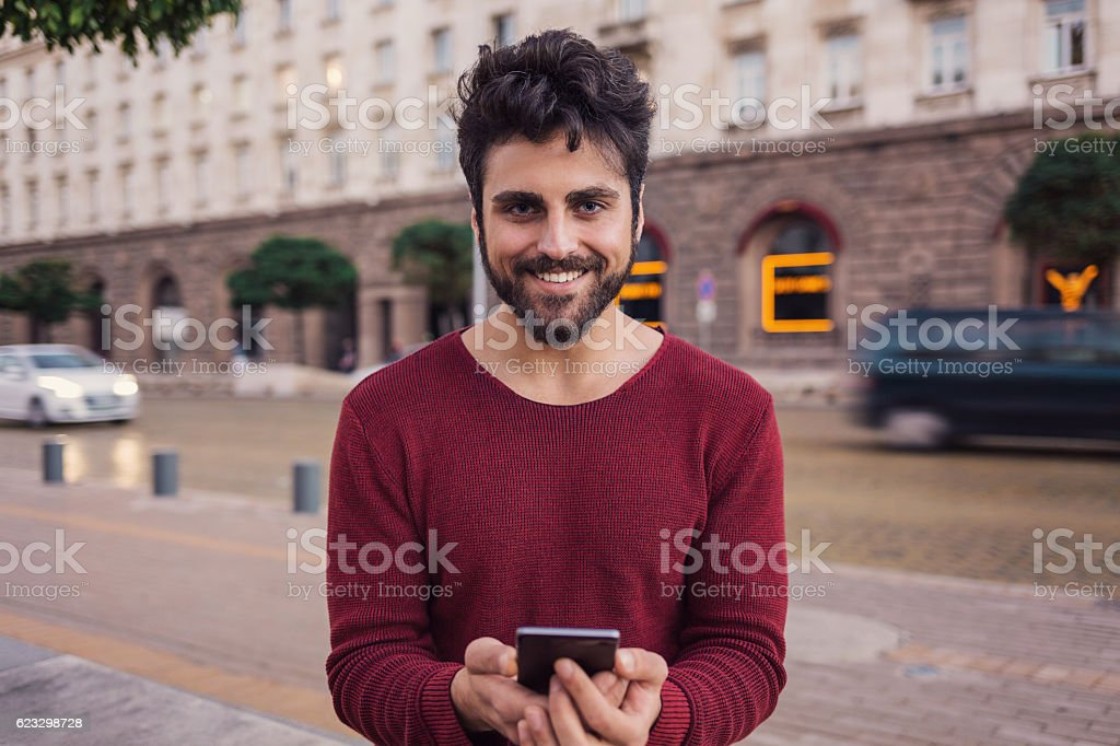 Handsome guy with smartphone stock photo