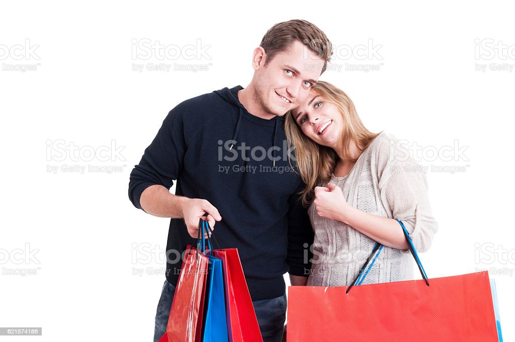 Handsome happy couple holding bunch of shopping bags photo libre de droits
