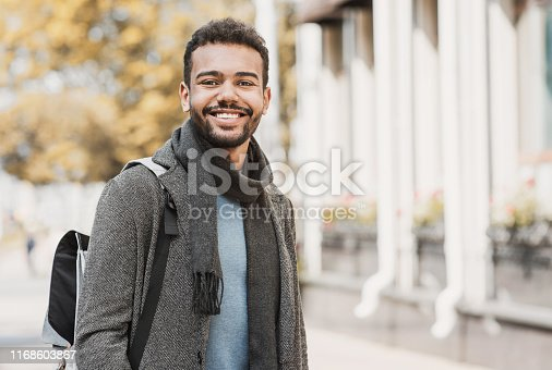 Joyful smiling men in a city. Autumn and winter concept