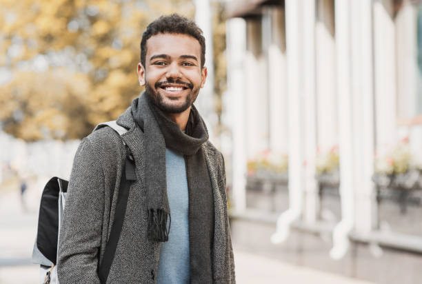 Handsome happy man autumn portrait Joyful smiling men in a city. Autumn and winter concept waist up stock pictures, royalty-free photos & images