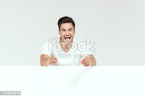 istock Handsome happy man with empty background. 1016143918