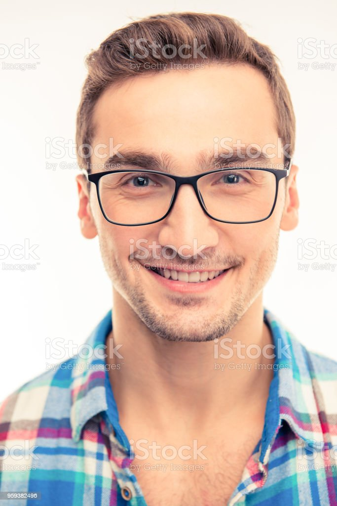 Handsome happy man with his glasses stock photo