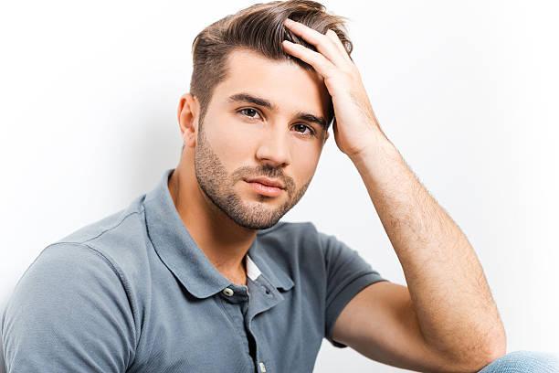 Handsome heartbreaker. stock photo