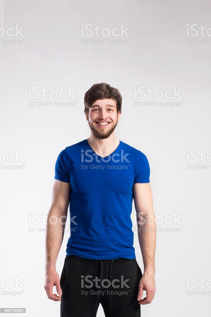 Handsome hipster fitness man in blue t-shirt, studio shot. royalty-free stock photo