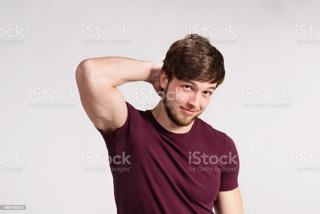 Handsome hipster fitness man in burgundy t-shirt, studio shot. royalty-free stock photo
