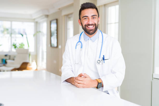 Handsome hispanic doctor man wearing stethoscope at the clinic with a picture id1134256105?b=1&k=6&m=1134256105&s=612x612&w=0&h=qcqhrhonxj5skx qpimaysa9p1hniuoerkuh35evhby=