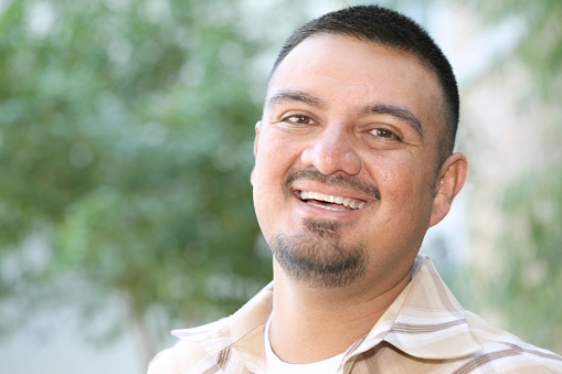 Handsome Hispanic Male Having A Laugh Stock Photo - Download Image Now