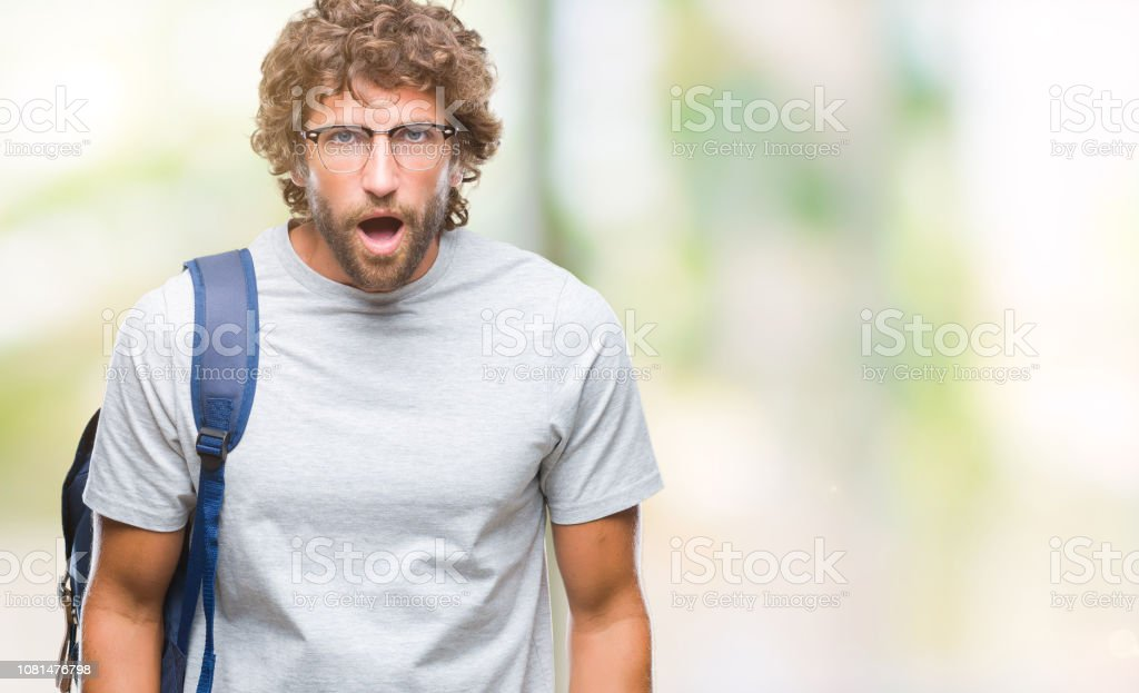 Handsome hispanic student man wearing backpack and glasses over...