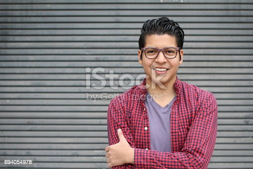 istock Handsome Hispanic Young Male with Copy Space 694054978