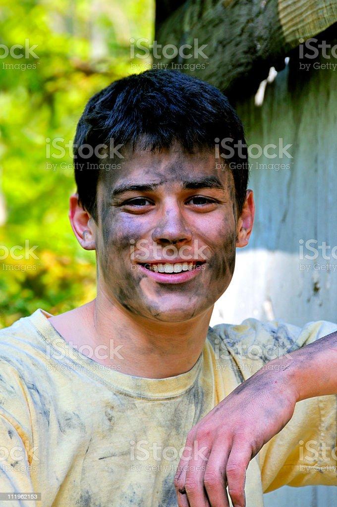 Handsome Homeless Teen Smiles for Camera - Stock image .