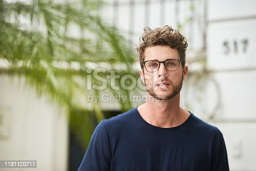 Handsome young guy in glasses, portrait