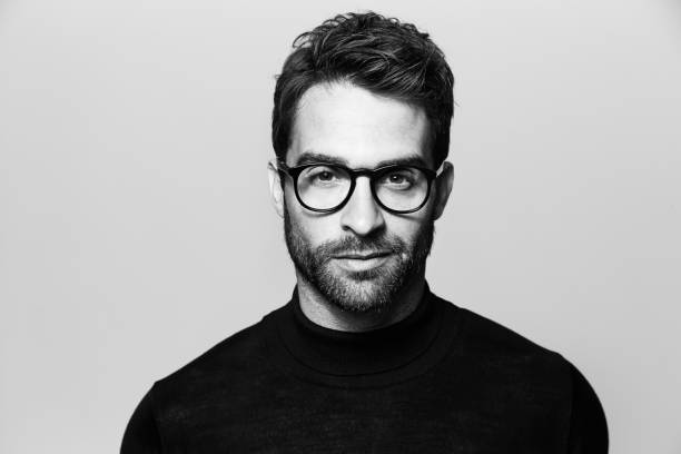 Handsome in spectacles Handsome man in spectacles, portrait black and white stock pictures, royalty-free photos & images