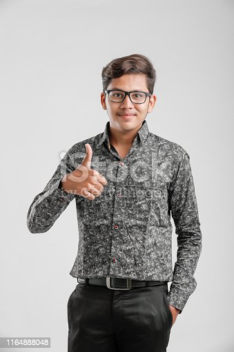 Handsome Indian / Asian teen boy showing thumbs up.