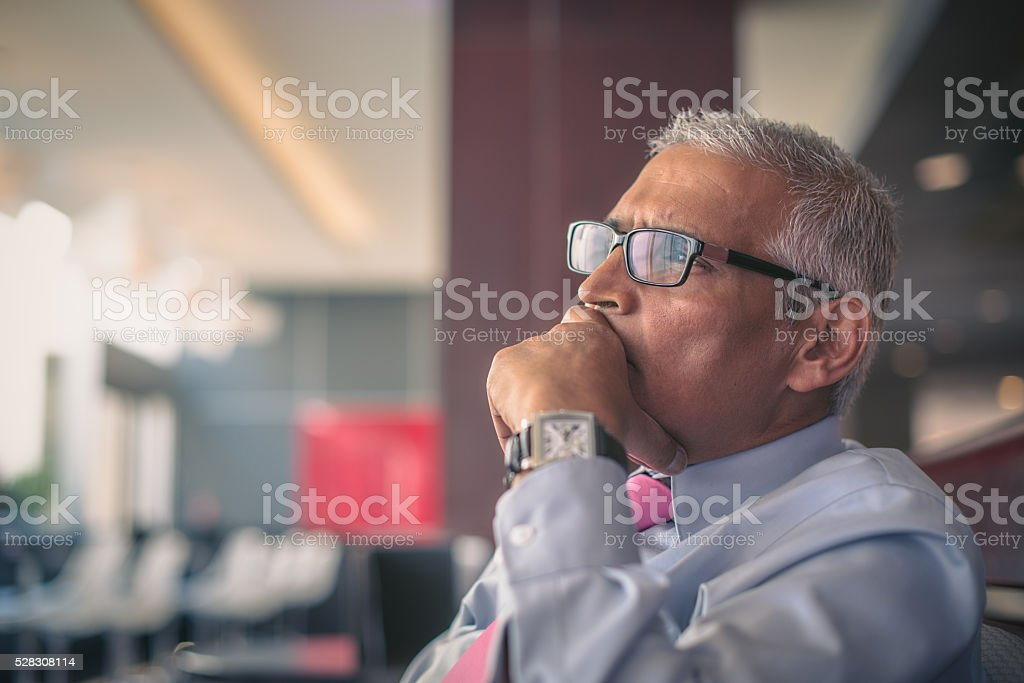 Handsome Indian Businessman Executive decision stock photo