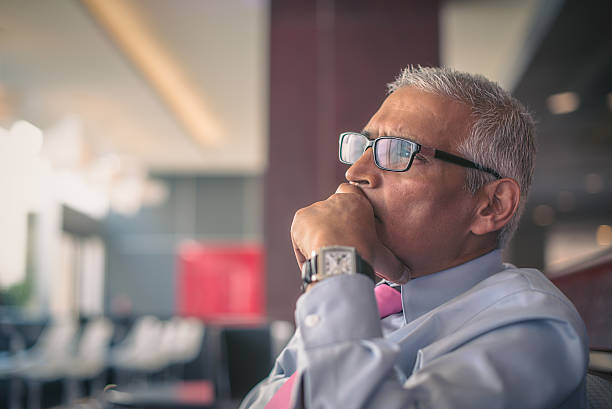 Handsome Indian Businessman Executive decision stock photo