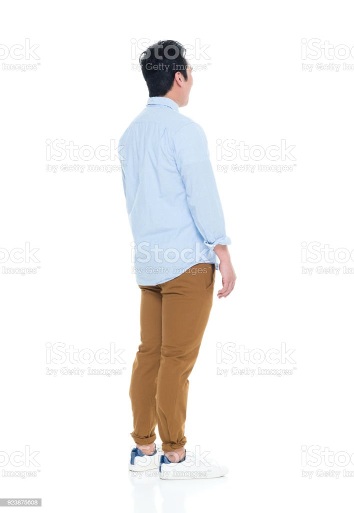 Handsome Korean Male arms to the side stock photo