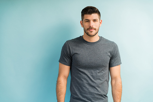 Handsome Latin Man Against Turquoise Background