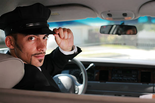 handsome limo driver - limousine service stock photos and pictures