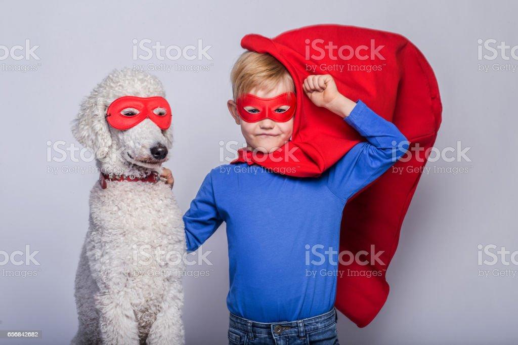 Photo De Stock De Beau Petit Superman Avec Chien Superhéros