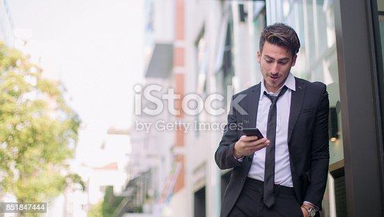 istock Handsome looking businessman 851847444