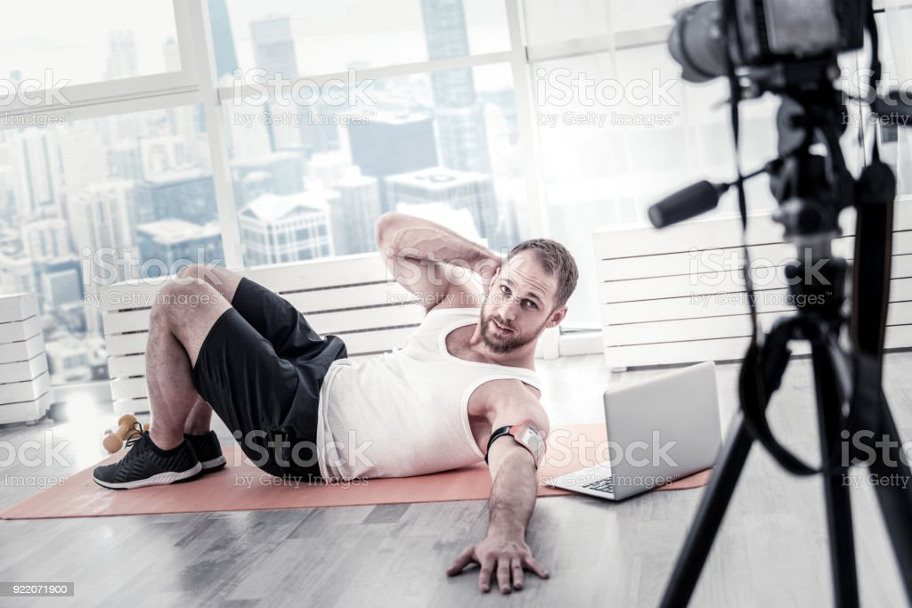 Handsome male blogger perfecting abs stock photo