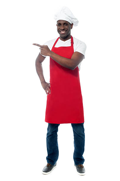 Handsome male chef showing menu stock photo