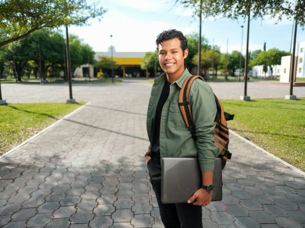 Handsome male college student stock photo