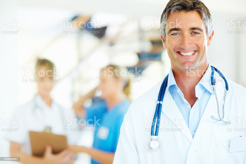 Handsome male doctor smiling royalty-free stock photo