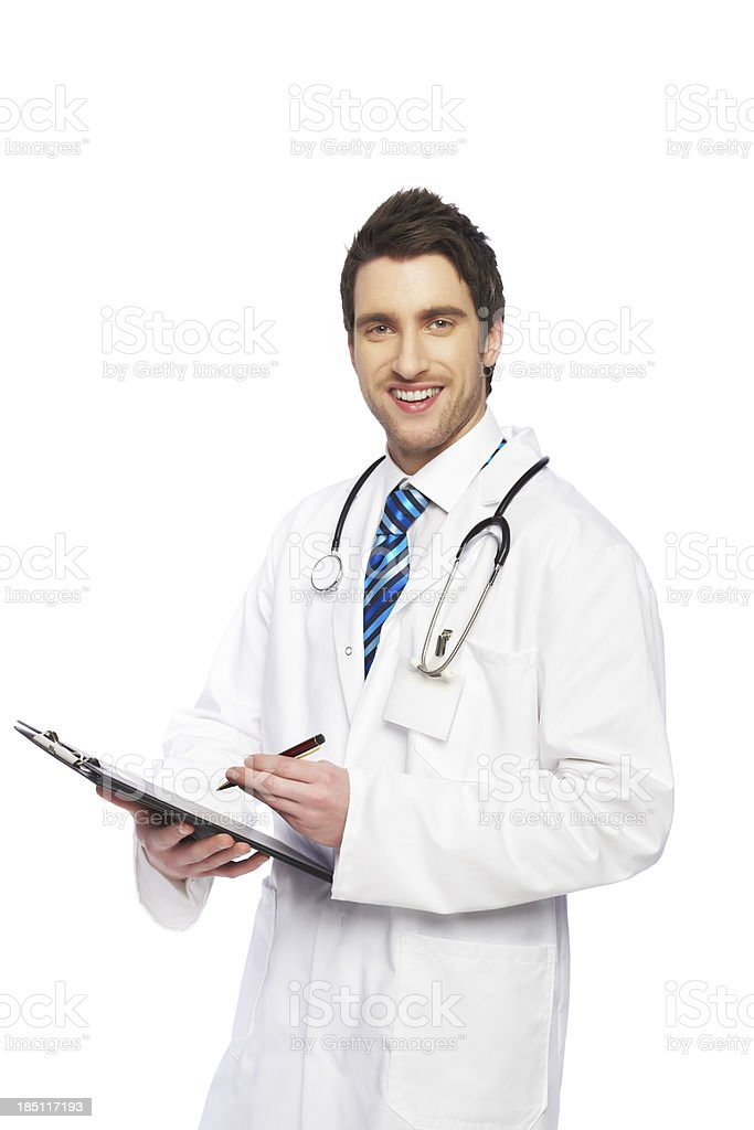 Handsome male doctor writing on a report stock photo