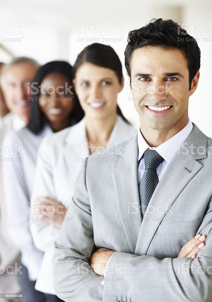 Handsome, male executive smiling with colleagues royalty-free stock photo