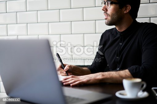 istock Handsome male hipster journalist 682869330