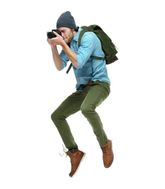 Schöne männliche Fotograf hält DSLR-Kamera und fotografieren – Foto