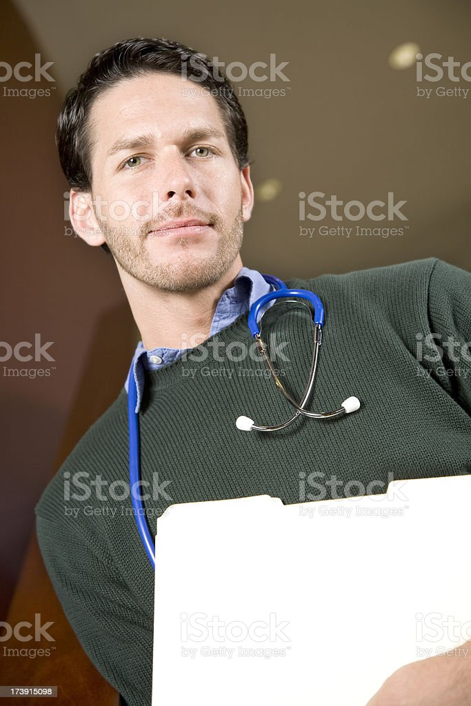 A handsome male Physician coming down the stairs royalty-free stock photo