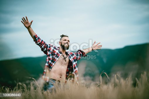 Handsome Male Walking Through Fields And Enjoying Freedom