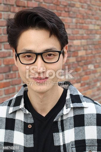 689644378istockphoto Handsome male with glasses portrait 846743222