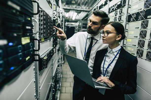 handsome man and attractive woman are working in data centre. - being in a relationship with someone is going to require stock photos and pictures