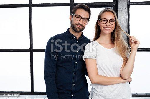 istock Handsome man and beautiful woman in glasses, portrait 621571482